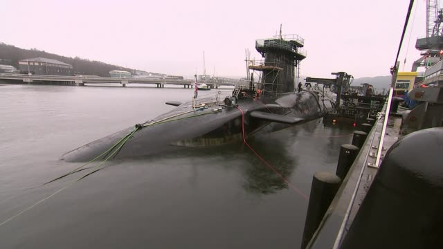 mps debate renewal of trident lib faslane naval base ext trident nuclear submarine 'vigilant' in dock crew member at work in control room - trident stock videos & royalty-free footage