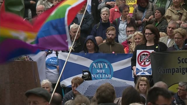 glasgow ext various shots protesters with flags demonstrating against trident renewal outside glasgow royal concert hall various shots children... - trident stock videos & royalty-free footage