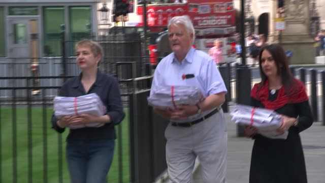 ministry of defence cnd members along with petition petition held gv cnd members posing outside ministry of defence with petition anti trident... - trident stock videos & royalty-free footage