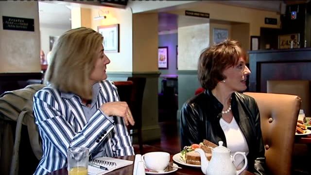 Esther Rantzen campaigning in Luton INT Esther Rantzen and reporter in cafe watching TV coverage of Speaker Michael Martin announce his resignation...