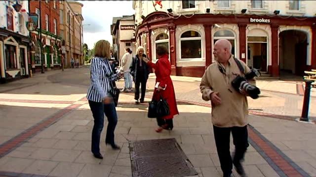 Esther Rantzen campaigning in Luton Luton EXT Rantzen talking to local man in street SOT