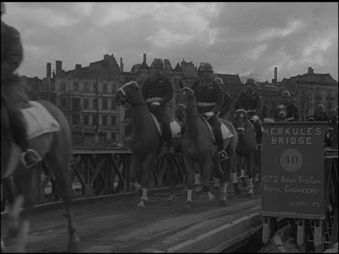 MPs on horseback in Berlin ruins of Kaiser Wilhelm Memorial Church BG MS Mounted MPs across 'Hurkules Bridge' WS Allied soldiers checking civilian...