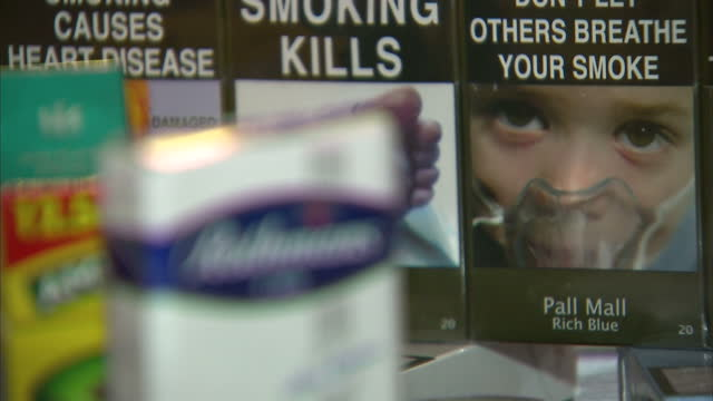 MPs to vote on new law re cigarette packaging before the general election Shows interior shots cigarette packaging of various brands with health...