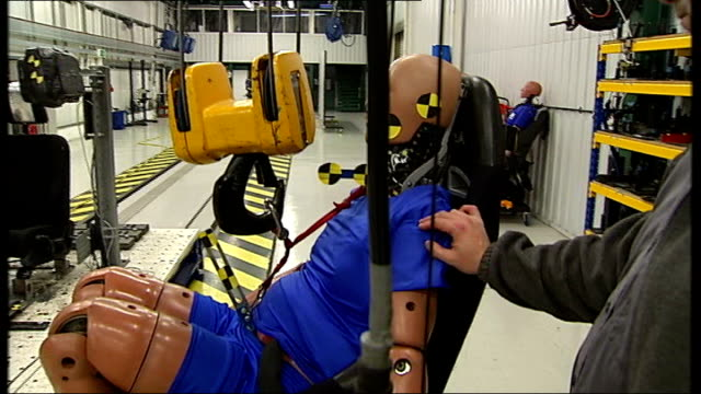 mps urge higher threshold for compensation over whiplash injuries england thatcham berkshire factory workers preparing test for crash test dummy... - crash test stock videos & royalty-free footage