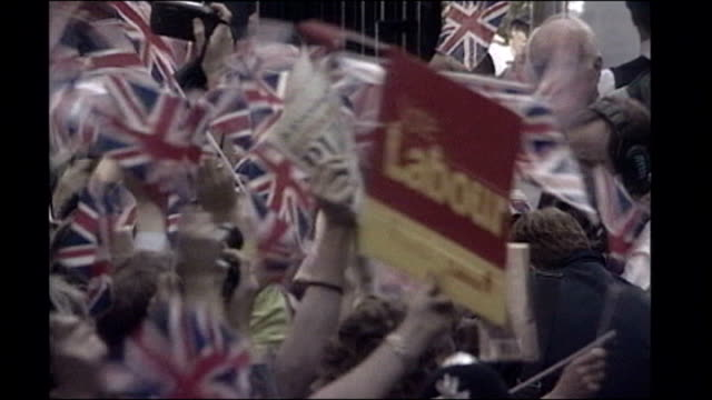 vídeos y material grabado en eventos de stock de mps vote in favour of fully elected house of lords tx crowds waving union jack flags and labour placard - placard