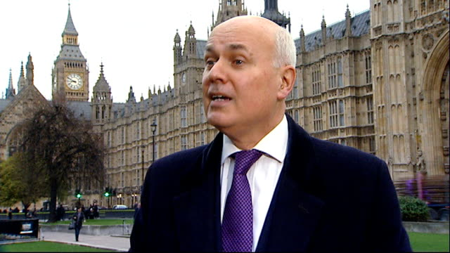 mps vote on benefits cap; iain duncan smith mp interview sot - the real tax on strivers is what the labour government when they left office left us... - smith tower stock videos & royalty-free footage