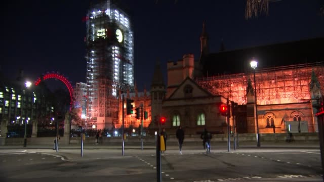 MPs vote to vacate building during Parliament restoration work ENGLAND London Westminster Close shot Parliament Square sign PAN Big Ben clock tower...