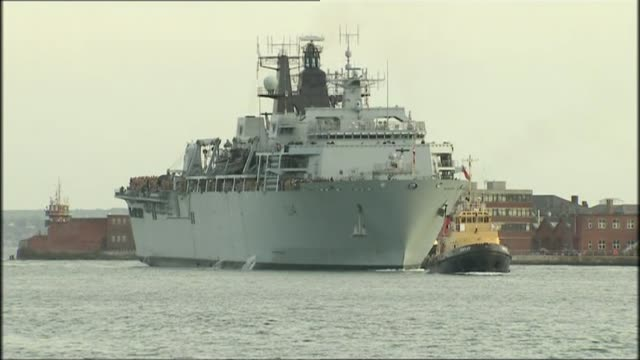 MPs warn cuts to the Royal Marines would undermine UK security LIB / Portsmouth HMS Albion arriving guided by tug boat in Portsmouth harbour