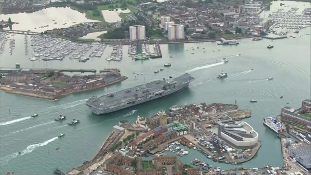 MPs warn cuts to the Royal Marines would undermine UK security R160817003 / Hampshire Portsmouth Aircraft carrier HMS Queen Elizabeth along with tugs...