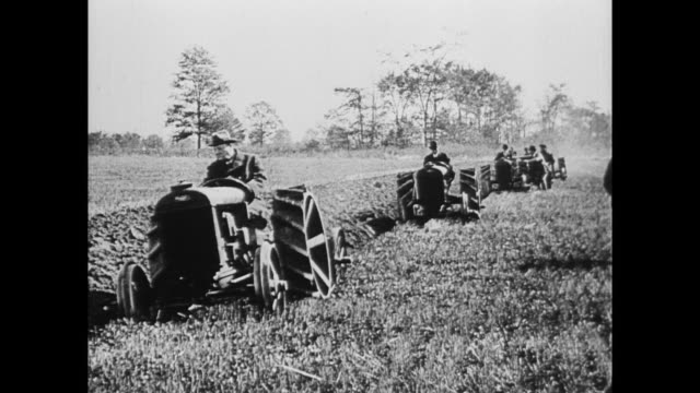 mr alfred harmsworth , head of british war mission, tests ford tractors along with henry ford. - peerage title stock videos & royalty-free footage