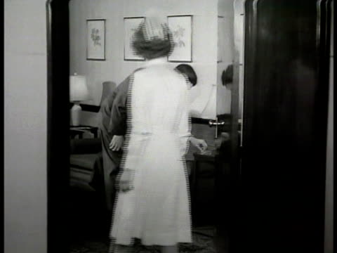 mr conrad mrs conrad's father in hospital waiting room nurse saying wife alright family relieved nurse w/ mrs conrad in hospital room wiping face for... - 1948 stock videos and b-roll footage