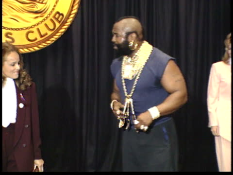 Mr T greets Sherry Belafonte and Sugar Ray Leonard on stage before ceremony