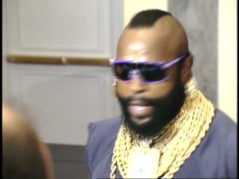 mr t having animated conversation with reporters and posing for paparazzi on red carpet - friars roast 1993 stock videos and b-roll footage