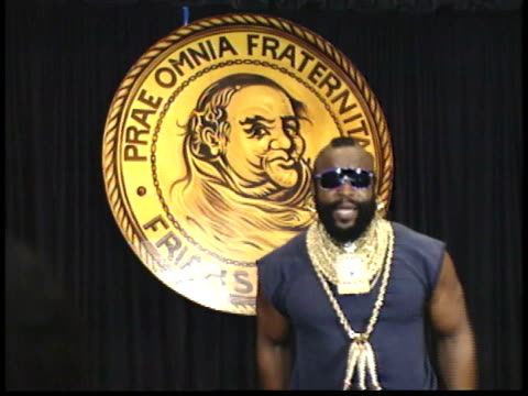 mr t stands on stage in front of friars club logo talking to reporters before walking off - friars roast 1993 stock videos and b-roll footage