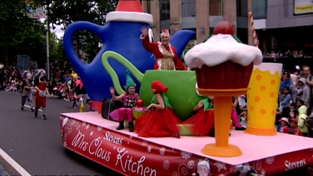 mrs claus character on float as part of annual farmers santa parade along queen street in auckland - weihnachtsfrau stock-videos und b-roll-filmmaterial