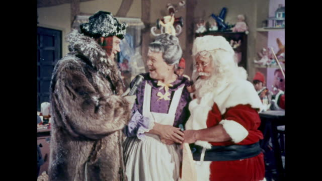 1964 mrs. claus is very excited to learn she's on television - weihnachtsfrau stock-videos und b-roll-filmmaterial