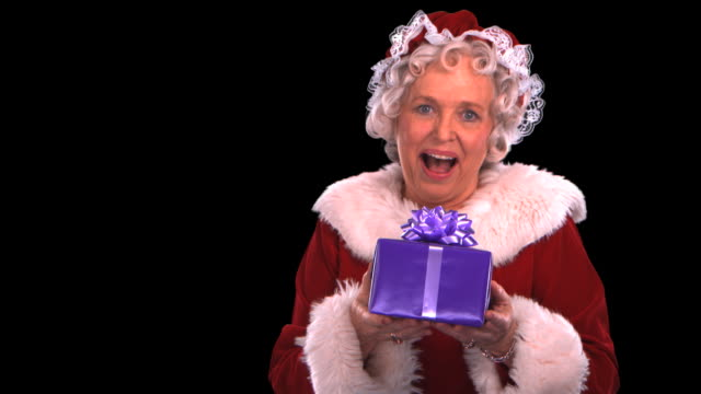 mrs. claus smiling close-up - this clip has an embedded alpha-channel - weihnachtsfrau stock-videos und b-roll-filmmaterial