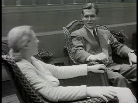 'mrs conrad' in robe sitting outside w/ husband talking 'mrs conrad' dressed to leave hospital talking w/ doctor husband shaking surgeon's hand nurse... - 1948 stock videos and b-roll footage