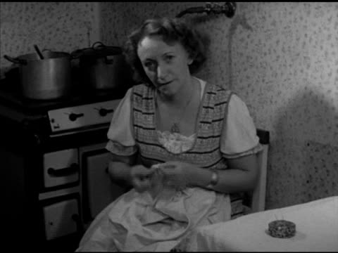 economy dramatization ms 'mrs gertner' sewing husband's shirt by hand sot in german saying husband is engineer w/ state railroad two children earns... - hausfrau stock-videos und b-roll-filmmaterial