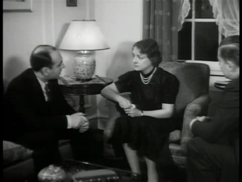 dramatization 'mrs glubber' talking w/ private detective daniel eisenberg sot eisenburg asking questions 'wife' answering eisenburg looking through... - detective stock videos and b-roll footage