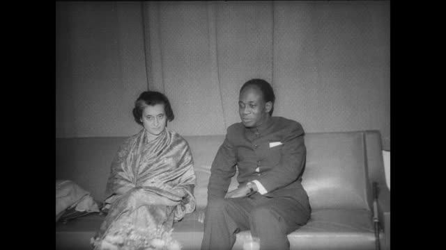 mrs indira gandhi prime minister of india meets president kwamme krumah of ghana / the two leaders walk along talking / gandhi and krumah on couch... - indira gandhi stock videos & royalty-free footage