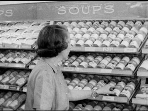 mrs. josephine wildley' entering 'donahoe's' supermarket store, shopping for canned soup, other grocery items, paying out w/ cashier , register... - soup stock videos & royalty-free footage