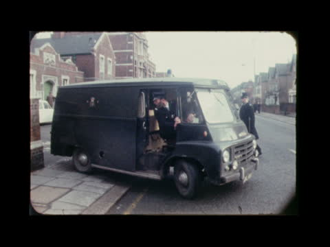 stockvideo's en b-roll-footage met mrs muriel mckay murder: hosein brothers driven to court; england: london: wimbledon: ext black maria' towards along street and turns corner l-r:... - crime and murder