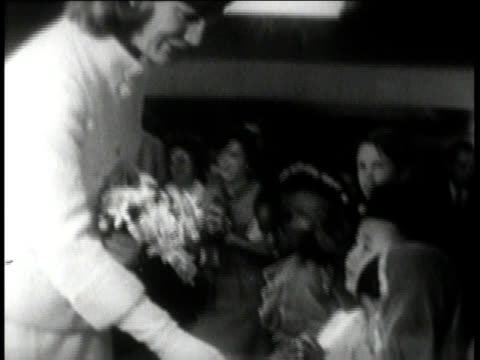 stockvideo's en b-roll-footage met mrs. onassis meeting with children / mrs. onassis posing for pictures with children - 1960 1969