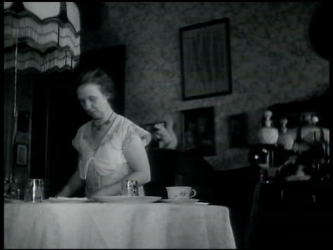 mrs perkins setting table in dining room two male teen sons in shirt tie reading fred perkins entering kitchen washing hands in hand sink explaining... - 1935 stock videos & royalty-free footage