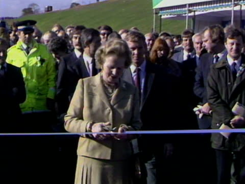 mrs thatcher cuts a ribbon to officially open the final section of the m25 motorway. 29 october 1986. - m25 video stock e b–roll