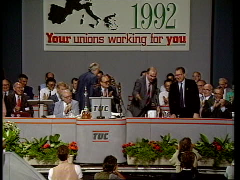 Mrs Thatcher EEC speech in Belgium ITN LIB Dorset Bournemouth TMS People sitting on TUC conference plaform applauding as Jacques Delors introduced...