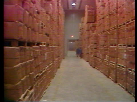 Mrs Thatcher EEC speech in Belgium ITN LIB MS Pallets loaded with cases of EC surplus food piled up TRACK MS Pallets piled high TMS Sacks of grain on...
