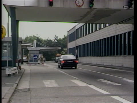 Mrs Thatcher EEC speech in Belgium ITN LIB Aachen AV 'Aachen Zollamt AutobahnSud' sign on building across road at border TILT DOWN as car along road...