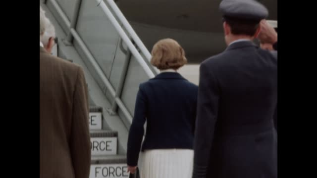 Mrs Thatcher leaves for talks NAO Story MS Margaret Thatcher walks to plane with RAF officials MS Husband Dennis Thatcher along BV All up plane steps...