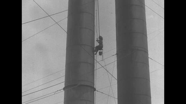 mrs tom wassela uses a pulley to ascend a smokestack / she's inching up halfway / while at the top of the smokestack she removes a brush from a... - pulley stock videos & royalty-free footage