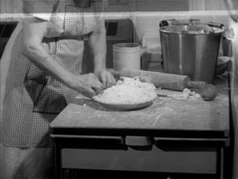 mrs violet oaster aka 'mickey' in kitchen room of the diesel boat shannopin preparing pie crust josephine bennett putting out dishes of food at the... - galeere stock-videos und b-roll-filmmaterial