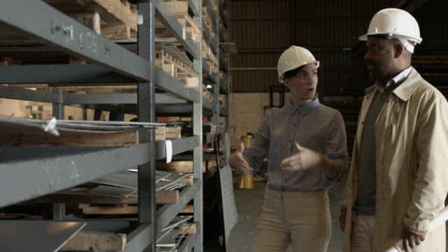 ms_architect and ingenieur inspecting steel sheets at steel plant - ingenieur stock videos & royalty-free footage
