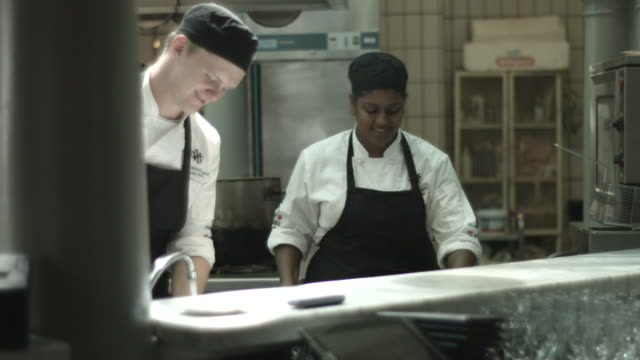 MS_Chefs preparing dishes in open kitchen, at restaurant