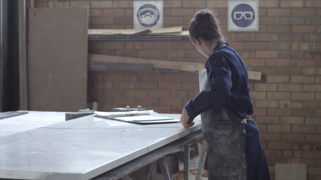 MS_Female factory worker measuring marble slab