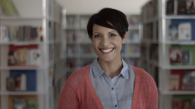 ms_portrait of teacher in library at school - short hair stock videos & royalty-free footage