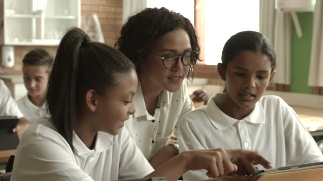 MS_Teacher assisting students with digital tablets
