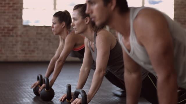 MS_Three people doing push-up's in urban gym gym