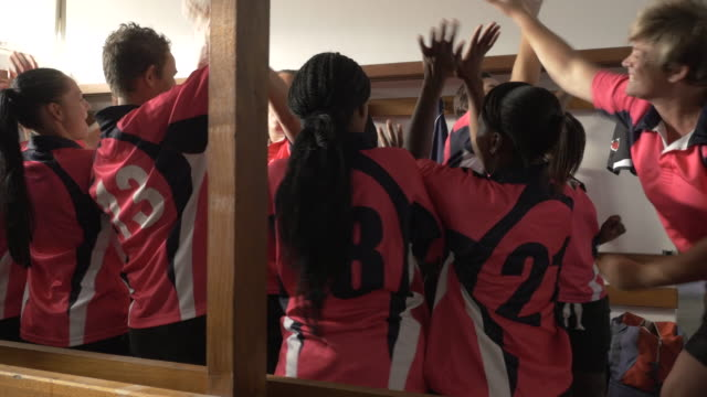 stockvideo's en b-roll-footage met ms_womens rugby team cheering and showing team spirit in the locker room before the game - rugby sport