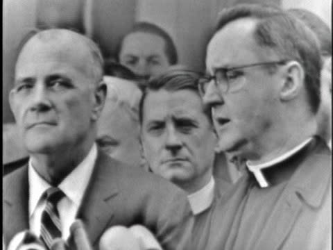 msgr. george c. higgins of the national catholic welfare conference holds a press conference about a meeting on civil rights protests with us... - アメリカ公民権運動点の映像素材/bロール