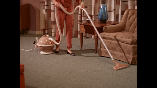 mslegs of woman vacuuming the livingroom carpet / united states - vacuum cleaner stock videos & royalty-free footage