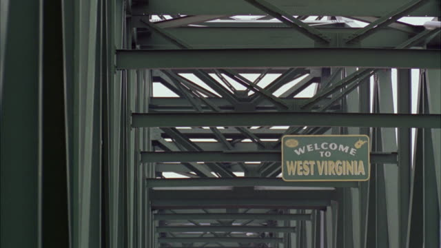 msshot of bridge with welcome to west virginia sign on board / unspecified - welcome sign stock videos & royalty-free footage