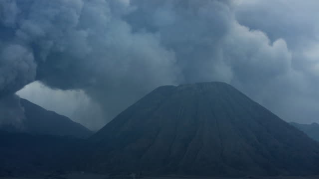 mt bromo eruption smoke and ash java indonesia - bromo crater stock videos & royalty-free footage