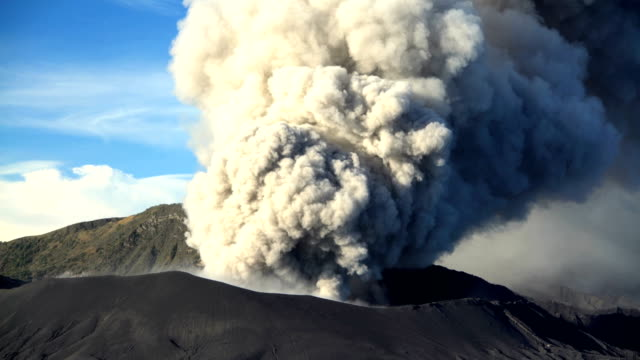 mt bromo volcano erupting smoke and ash java - erupting stock videos & royalty-free footage