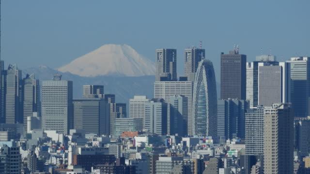 mt fuji and shinjuku buildings - lockdown stock-videos und b-roll-filmmaterial