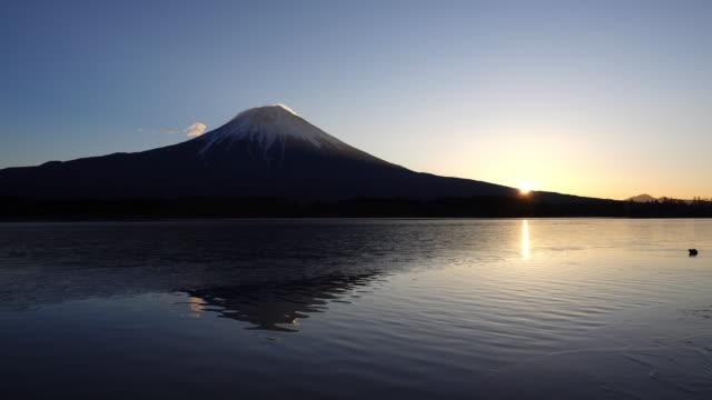 mt. fuji and the sunrise over lake tanuki - shizuoka prefecture stock videos and b-roll footage
